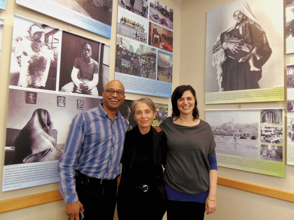 Praven Pather, Frances Everett, and Leila Durzi standing in front of the exhibit at the Cedar Hill Rec Centre cafe. —Emily Thiessen (photo)