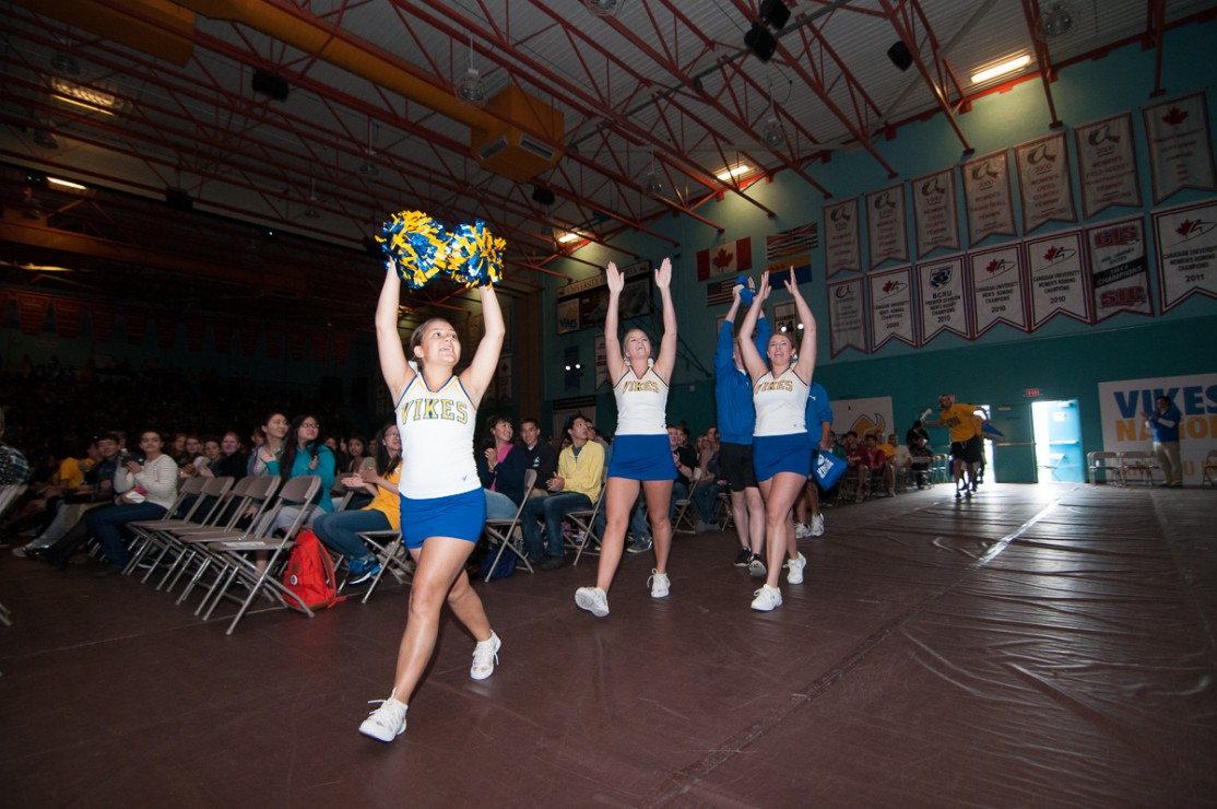 Members of the UVic Cheer Team pump up the crowd at the end of New Student Welcome on Sept. 2, 2014.