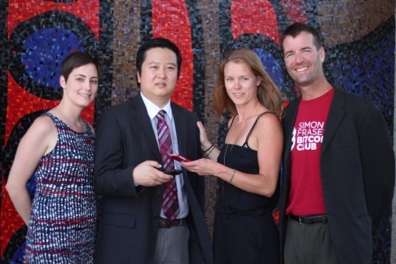 Fromleft: Lauren Shandley, Mike Yeung, Laurie Macpherson and Scott Nelson. Yeung and Nelson have made the first Bitcoin virtual currency donation to Simon Fraser University. The money will be used by Shandley and Macpherson for a humanitarian co-op project in India this fall. –Provided(photo)