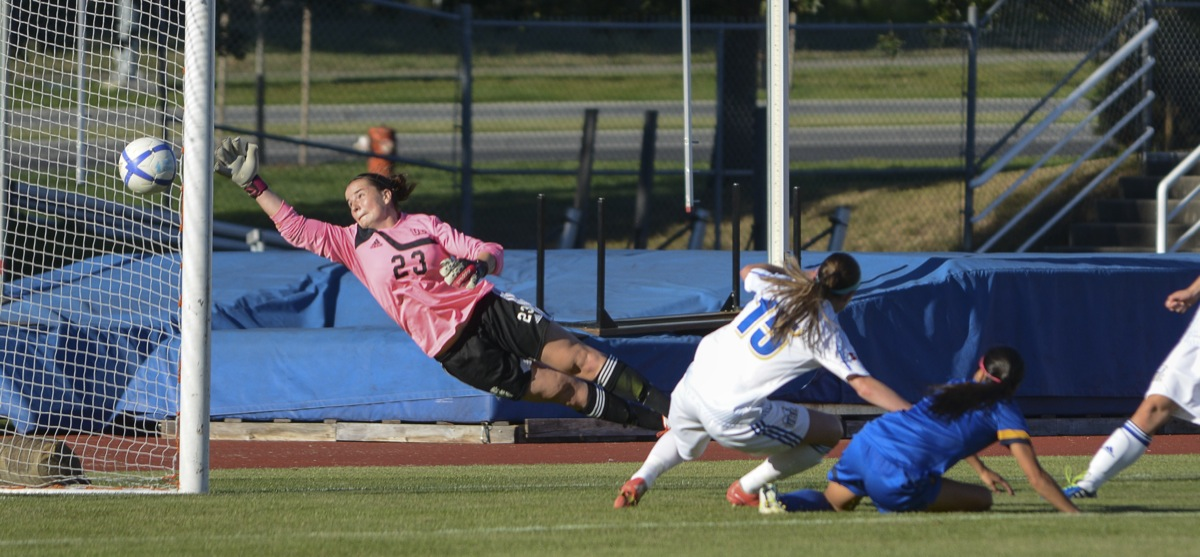 UBC goalkeeper Emily Wilson attempts to stop imminent goal from UVics' Jaclyn Sawicki. –Hugo Wong (photo)