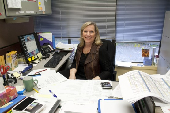 Island Sexual Health Society executive director Bobbi Turner poses in her office. The clinic, in operation for over 45 years, has cut back on staff and advertising to improve its finances after funding cuts. Photo by Sarah Allan (Photo Editor)