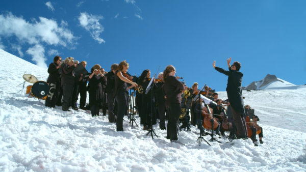 "Paul Walde conducts a performance of ""Requiem for a Glacier"" on a glacier. Photo by Douglas Noblet."