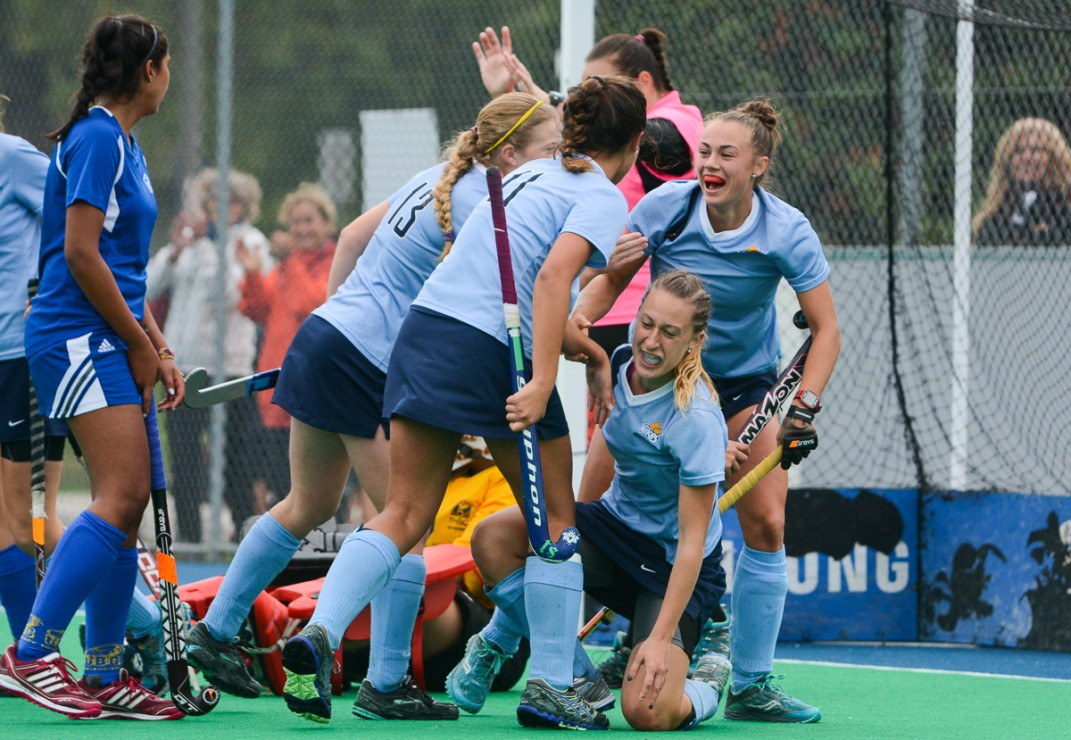 Members of the Vikes women's field hockey team celebrate after a goal against UBC on Oct. 12, 2014. The victory puts the Vikes at the top of the Canada West conference heading into the CIS championship in Toronto later this month. —Hugo Wong (photo)