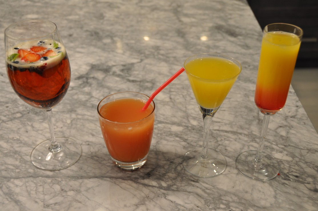 """Pictured from left to right: Pimms, Sea Breeze, the """"It's Fancier than Beer,"""" and a Tequila Sunrise. Mhmm. Photo by Sarah Lazin, Staff Writer"""