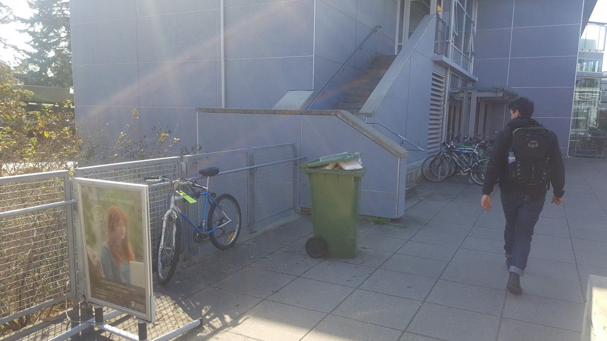 One student's bike (pictured above) can be seen locked up against a railing at the David Turpin building. Attached to the lock is a warning from campus security, threatening impoundment. Photo by Julian Kolsut, Contributing Writer