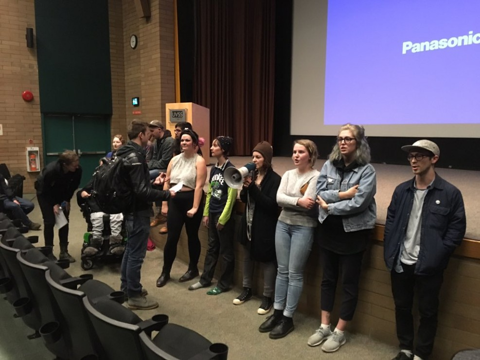 Protesters wait by the stage after demonstrating at an UVic Effective Altruism, featuring ethicist Peter Singer. Photo by Myles Sauer, Editor-in-Chief