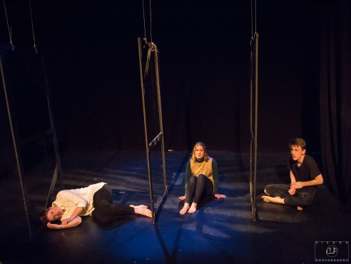 From left to right: Zoe (Mary Van Den Bosche), Leanne (Michelle Fortier), and Henry (Michael Bell) are faced with torture and death in a prisoner of war prison. Photo by Sierra C. F Photography