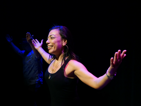 Carmen Aguirre demonstrates a salsa move for the audience of her production, 'Broken Tailbone'. Photo provided by UNO Fest