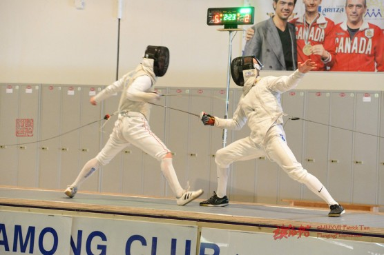 Caleb McIntosh, right, defeated Giorgi Gelashvili to win a provincial gold medal in fencing. Photo by Patrick Tam