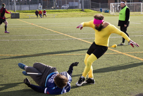 Brooms, Bludgers, Bruises: Quidditch, The 'snitch' tackles a UBC player in the Semi-Final match. Photo by Devon Bidal, Senior Staff Writer.