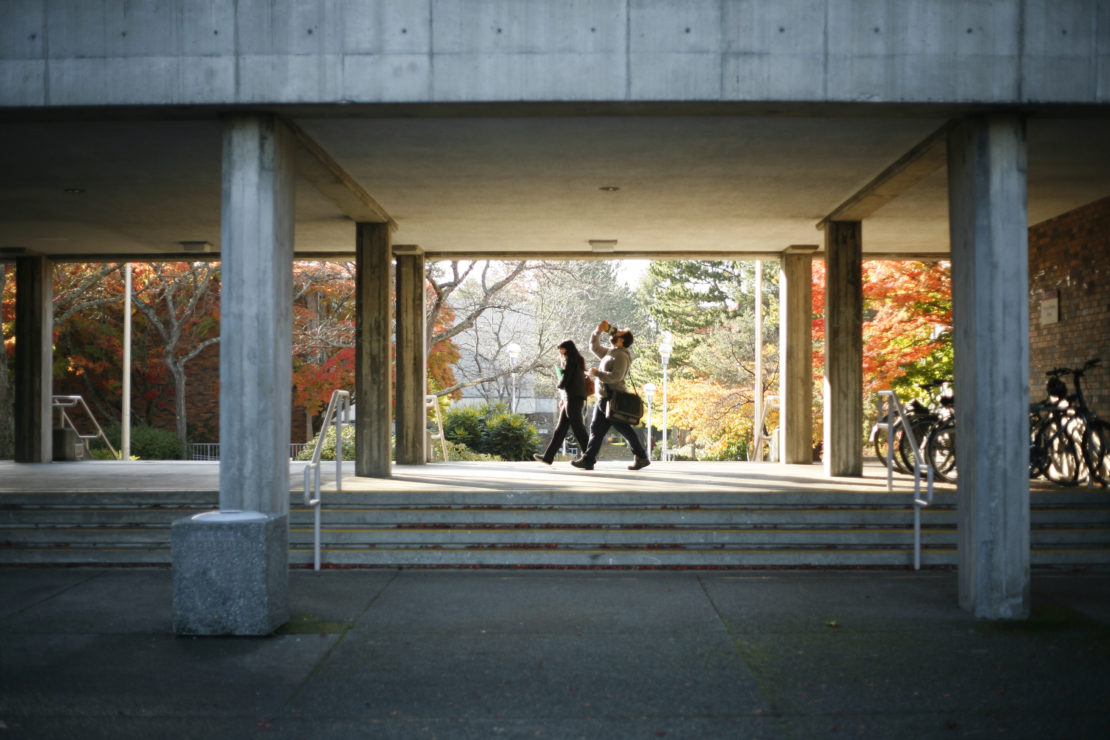 Students walk through UVic campus