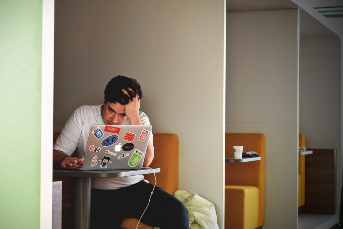 A student sits at a desk in university